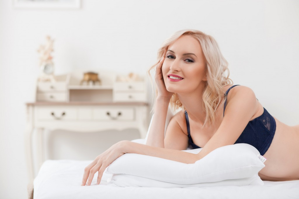 Pretty blond girl is luxuriating at home