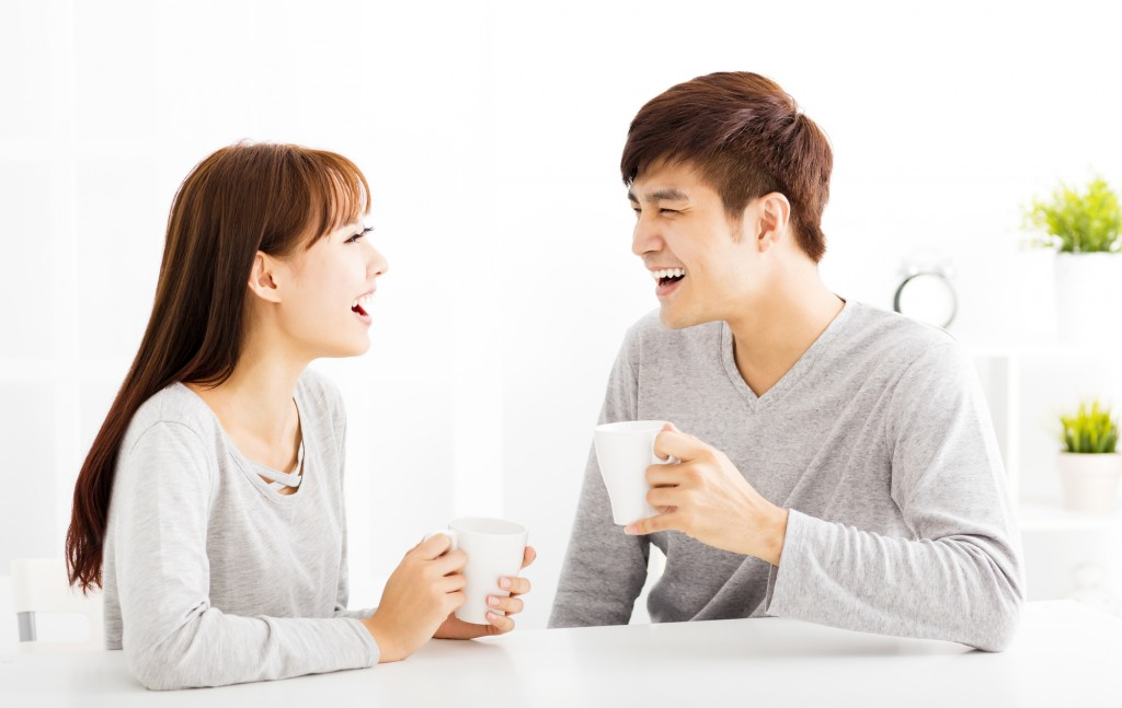 happy young Couple drinking coffee  In living room
